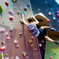 Young man on climbing wall.