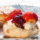Scone with strawberries, jam and cream.