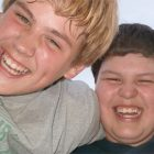 Close up of two boys laughing.