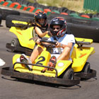 Young people in go karts on track.