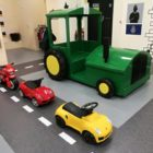 Play on tractor, two cars and a play motorbike at Little Street