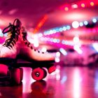 White roller boots with pink wheels