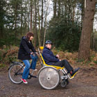 Mother and son on a tandem adapted bike.
