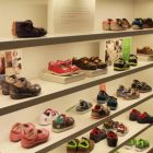 Shelves of children's shoes at Clarks.