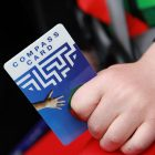 Compass Card in child's hand