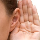 Hand cupped around ear to listen
